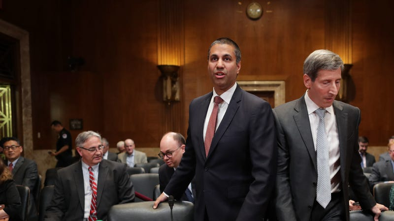 FCC Chairman Ajit Pai (L) and FTC Chairman Joseph Simons prepare to testify before the Senate Financial Services and General Government Subcommittee in the Dirksen Senate Office Building on Capitol Hill May 07, 2019 in Washington, DC.