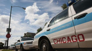 Police cars are parked outside a station in Chicago in 2011Scott Olson/Getty Images