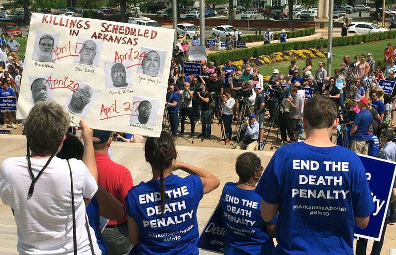 Protesters rally outside the Arkansas state Capitol in Little Rock on Friday, April 14, 2017, to protest the state's plan to execute 7 inmates this month. (AP Photo/Kelly P. Kissel)