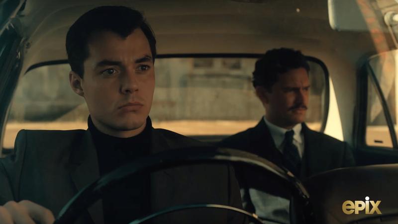 Alfred Pennyworth and Thomas Wayne sitting in a car.