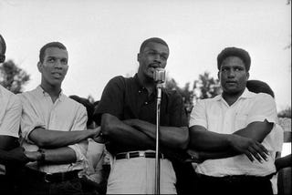 SNCC's Ivanhoe Donaldson, Marion Barry and James Forman protest police brutality.