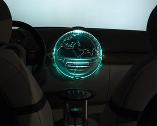 Illustration for article titled Mini Off-Road Crossover Concept Includes Laser-Projected 3D In-Car Entertainment Globe