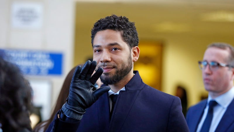Actor Jussie Smollett waves as he follows his attorney to the microphones after his court appearance on March 26, 2019 in Chicago, Illinois.