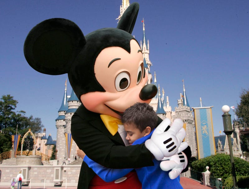 Illustration for article titled Kid With Rough Home Life Gives Mickey Extra Long Hug