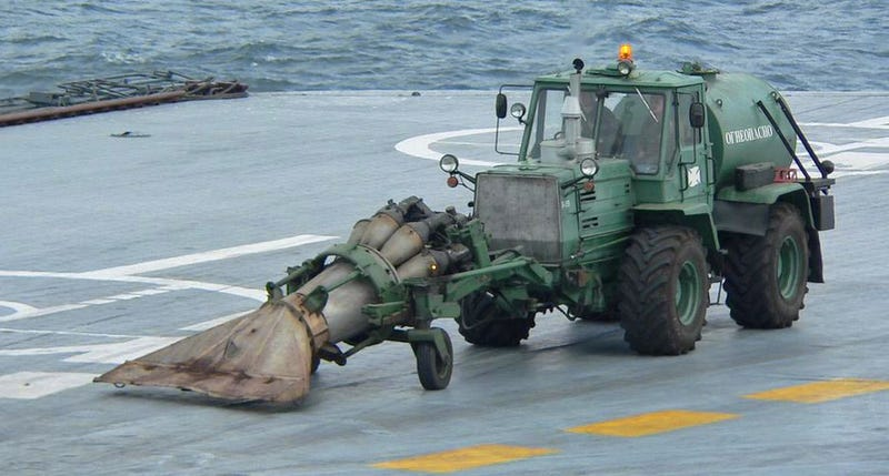 Illustration for article titled Russia Straps A Jet Engine To A Tractor To Clean Carrier Decks