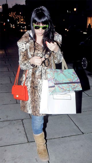 Illustration for article titled Lily Allen Hides Baby Bump With Shopping Bags, Leopard Print
