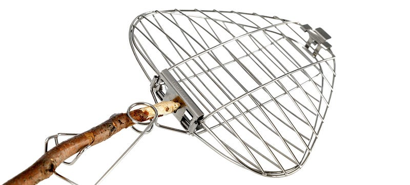 Illustration for article titled Put This Compact Grill On a Stick To Turn a Campfire Into a BBQ