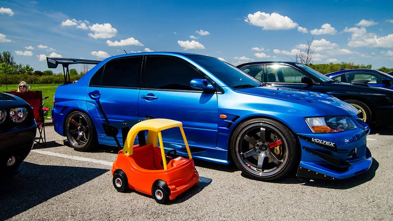 Illustration for article titled Guy creates stanced Cozy Coupe, instantly becomes dad of the year