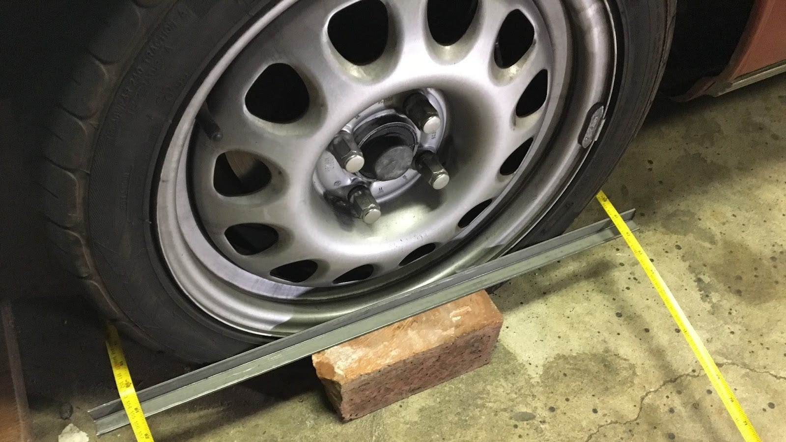 how to do your own alignment with some angle iron and two tape measures