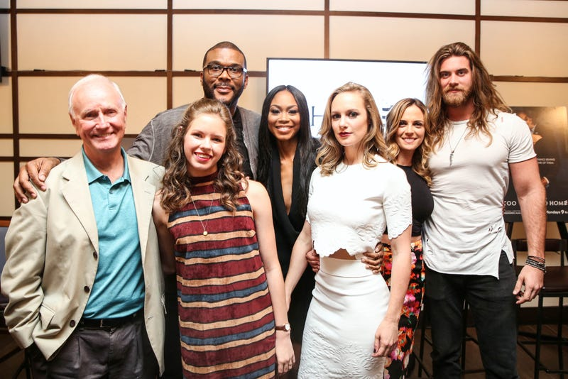 Producer Tyler Perry and cast members Danielle Savre, Brock O'Hurn, Kelly Sullivan, Ashley Love-Mills, Annie Thrash and Alpha Everette Trivette attend Atlanta Press Lunch for TLC's first scripted series, Too Close to Home, at the W Hotel Midtown on Aug. 9, 2016, in Atlanta.Robin L. Marshall/Getty Images