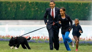 President Barack Obama and his daughters, Malia and Sasha, introduce their new dog, a Portuguese water dog named Bo, to the White House press corps on the South Lawn of the White House April 14, 2009.Chip Somodevilla/Getty Images