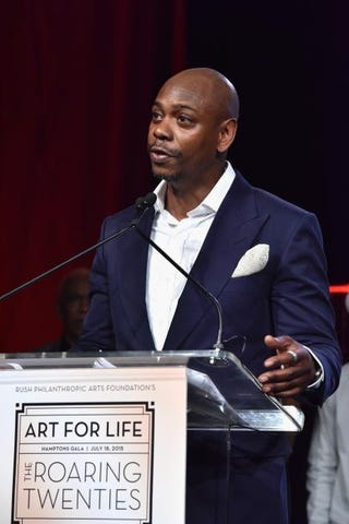 Dave Chappelle speaks onstage during the Rush Philanthropic Arts Foundation Celebrates 20th Anniversary at Art for Life event, July 18, 2015, in Water Mill, N.Y.Eugene Gologursky/Getty Images for Bombay Sapphire Gin