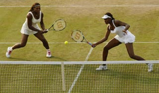 Serena and Venus Williams during their women's doubles match at the Wimbledon Tennis Championships in London on June 25, 2010GLYN KIRK/AFP/Getty Images