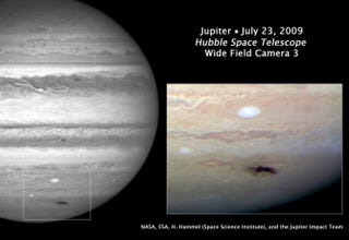 Illustration for article titled Sharpest Photo of Jupiter's Earth-Sized Scar Taken by Hubble