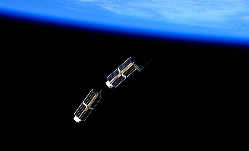 Illustration for article titled These Tiny Satellites Just Left The International Space Station