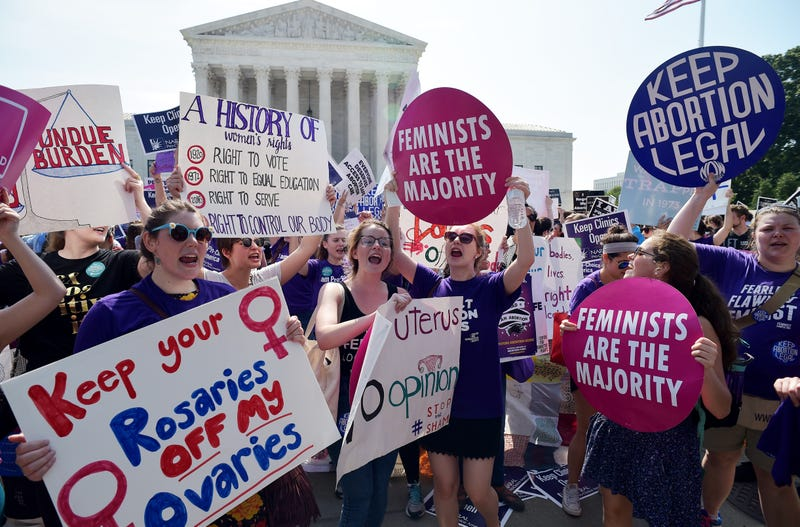 Abortion-rights activists cheer after the U.S. Supreme Court strikes down a Texas law placing extra restrictions on abortion clinics June 27, 2016, outside the Supreme Court in Washington, D.C.MANDEL NGAN/AFP/Getty Images