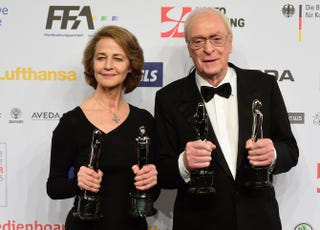 British actors Charlotte Rampling and Michael Caine pose with their trophies after the 28th European Film Awards ceremony in Berlin on Dec. 12, 2015. Both won a Lifetime Achievement Award as well as best actor and actress awards.JOHN MACDOUGALL/AFP/Getty Images