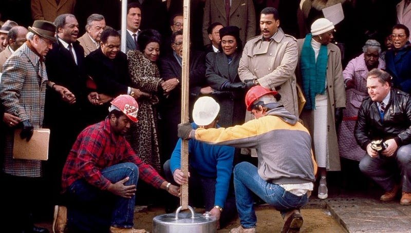 A time capsule is lowered into the ground after a ceremony by Coretta Scott King in 1988 (Library of Congress)