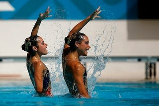 Illustration for article titled Synchronized Swimmers Always Do It With A Smile