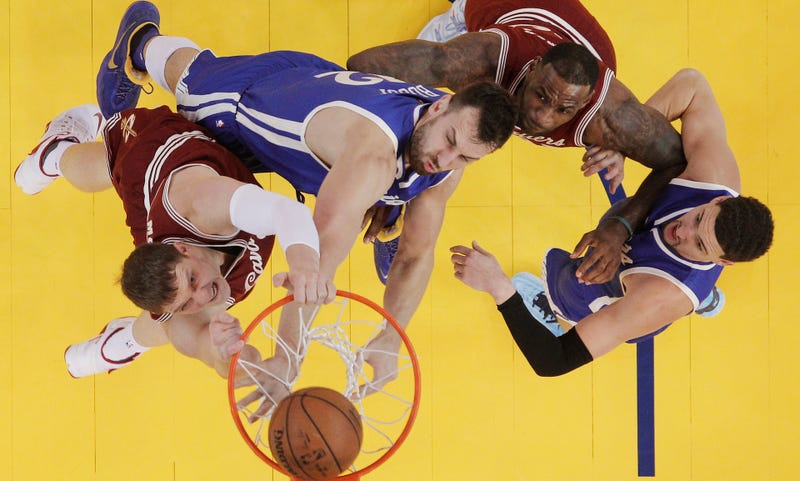 Like Twitter user @T_nels, Timofey Mozgov dunks on Andrew Bogut. (Photo credit: Marcio Jose Sanchez/AP)