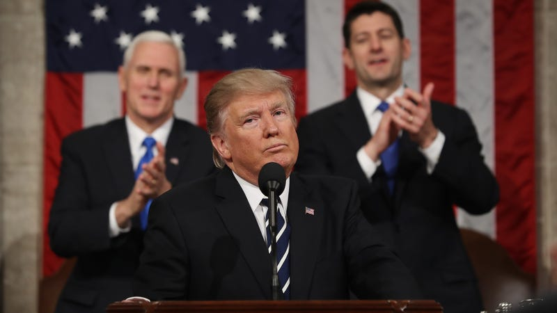 Vice President Mike Pence (left, background) and House Speaker Paul Ryan (right, background) applaud after President Donald Trump delivers his first address to a joint session of Congress on Feb. 28, 2017. (Jim Lo Scalzo/Getty Images)