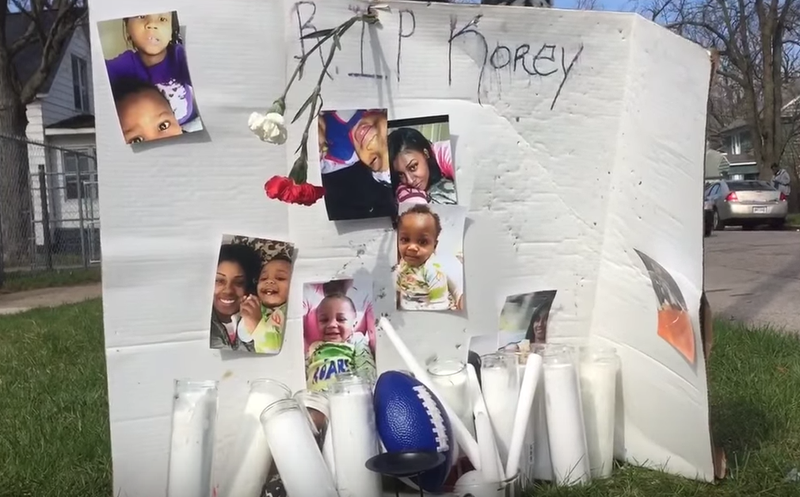 A memorial dedicated to 1-year-old Korey Brown, who was found dead inside a day care center last week (MLive via YouTube screenshot)