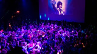 Guests dance to Prince music as a slideshow flashes images of the artist above the stage during a memorial dance party at the First Avenue nightclub April 21, 2016, in Minneapolis. Prince, 57, was pronounced dead April 21 shortly after being found unresponsive at Paisley Park Studios in Chanhassen, Minn., near Minneapolis.Scott Olson/Getty Images