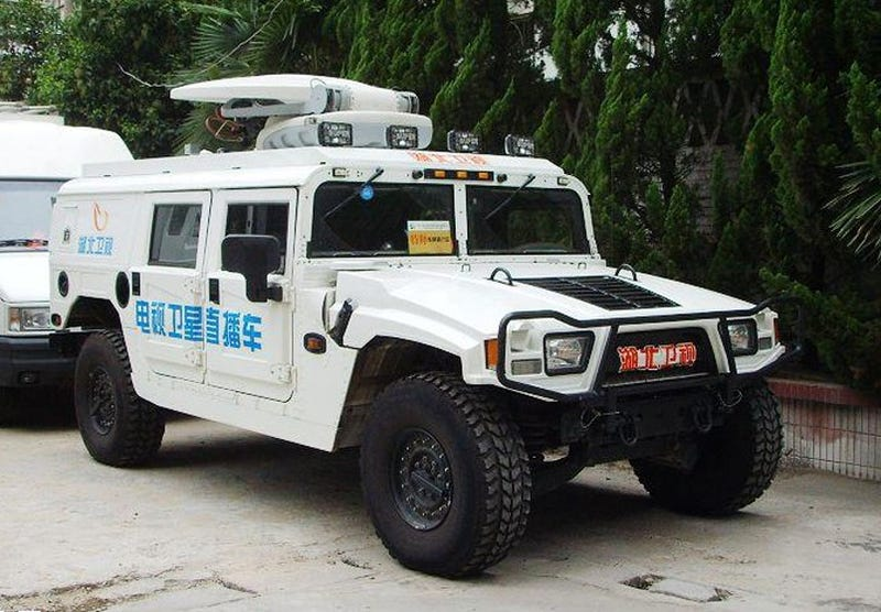 Illustration for article titled Chinese Hummer Satellite Truck: State Media's Beaming Face