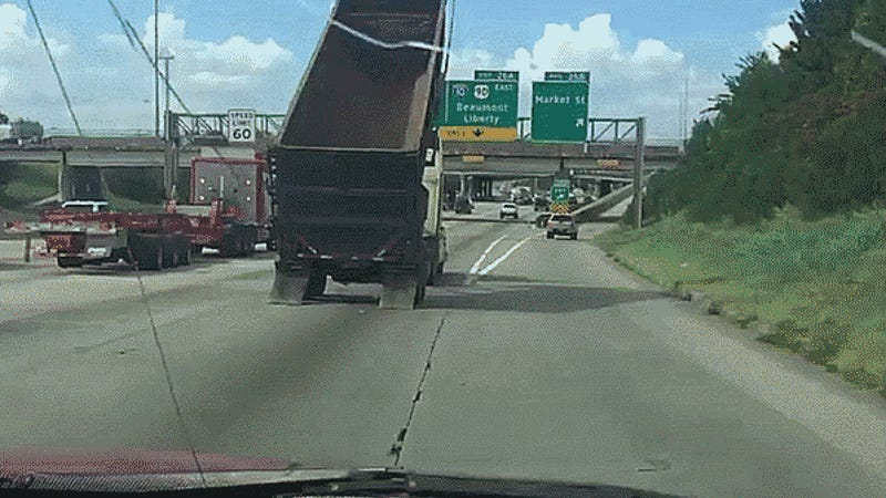 Oblivious Dump Truck Driver Takes Out Highway Sign, Chaos Ensues