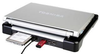 Illustration for article titled Laptop Cooler Features Slot-Loading Hard Drive Dock