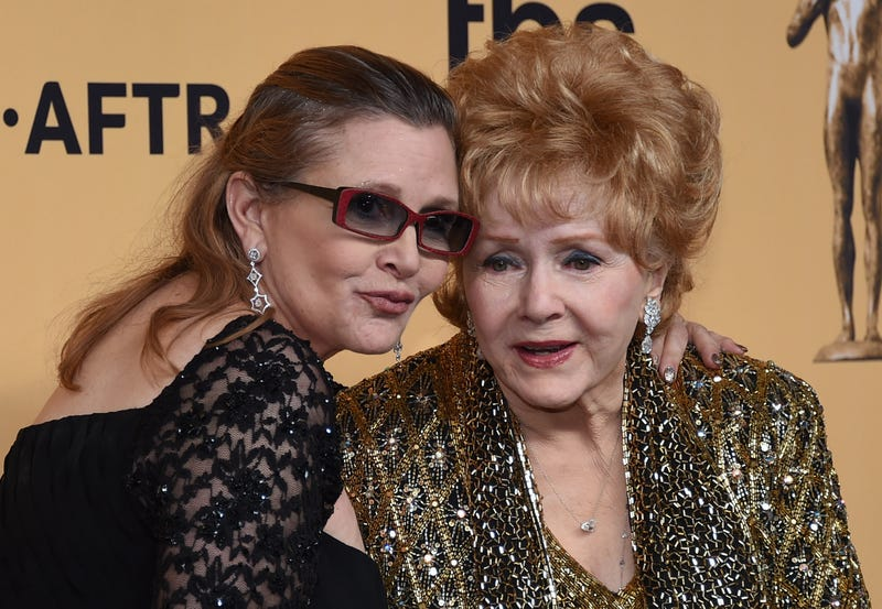Debbie Reynolds (right), recipient of the Screen Actors Guild Lifetime Achievement Award, and her daughter, Carrie Fisher, pose in the press room during the 21st annual Screen Actors Guild Awards at the Shrine Auditorium in Los Angeles on Jan. 25, 2015.Ethan Miller/Getty Images