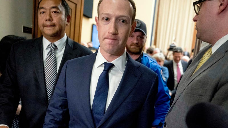 Facebook CEO Mark Zuckerberg departs after testifying before a House Energy and Commerce hearing on Capitol Hill in Washington, Wednesday, April 11, 2018, about the use of Facebook data to target American voters in the 2016 election and data privacy.