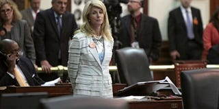 Texas state Sen. Wendy Davis stands after Democrats defeat the GOP abortion bill. (Erich Schlegel/Getty Images News)