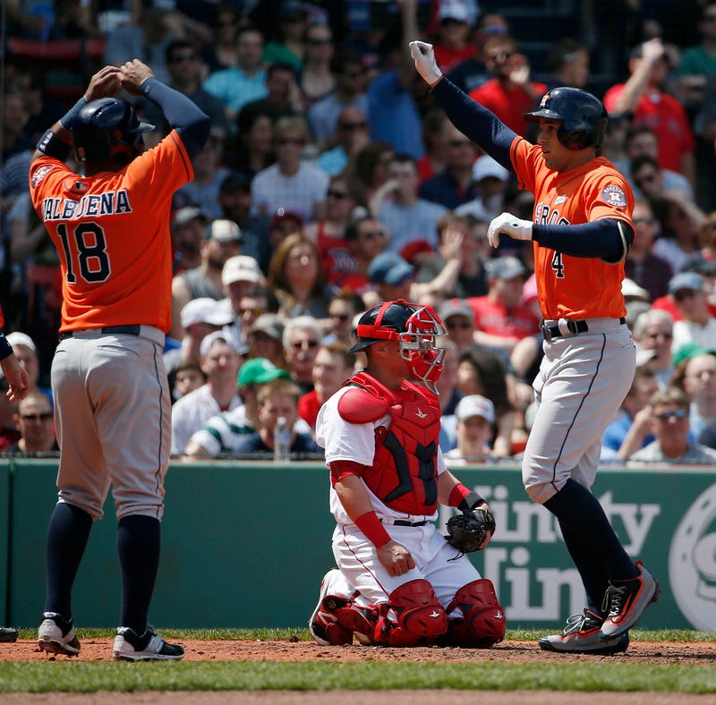 George Springer crosses home plate, via AP.