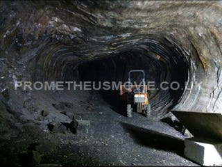 Illustration for article titled First Set Pics from Ridley Scott's Prometheus: Is this your new gritty alien underworld?