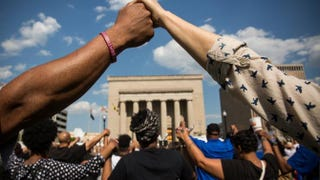 People hold hands during a rally led by faith leaders in front of Baltimore's City Hall May 3, 2015, calling for justice in response to the death of Freddie Gray.Andrew Burton/Getty Images