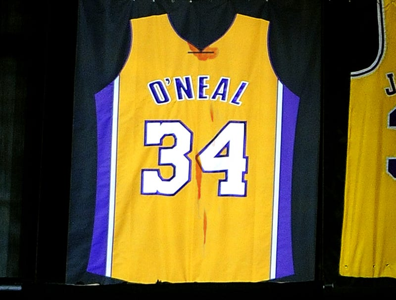 Illustration for article titled Lakers Add Buffalo Chicken Wing Stains To Shaquille O'Neal's Retired Jersey