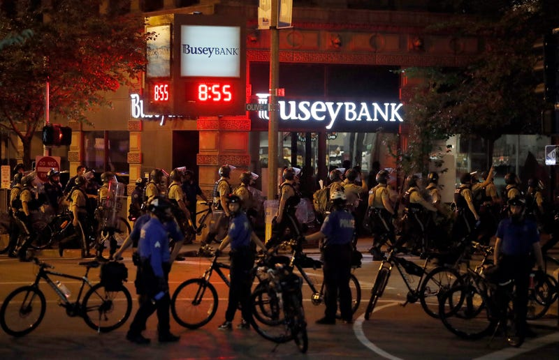 Police line up as protesters gather in St. Louis on Sept. 17, after a judge found Jason Stockley not guilty of first-degree murder in the death of Anthony Lamar Smith, who was fatally shot following a high-speed chase in 2011.
