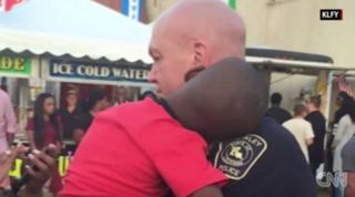 Viral photo of Crowley, La., Officer David Taylor carrying the sleeping childKLFY