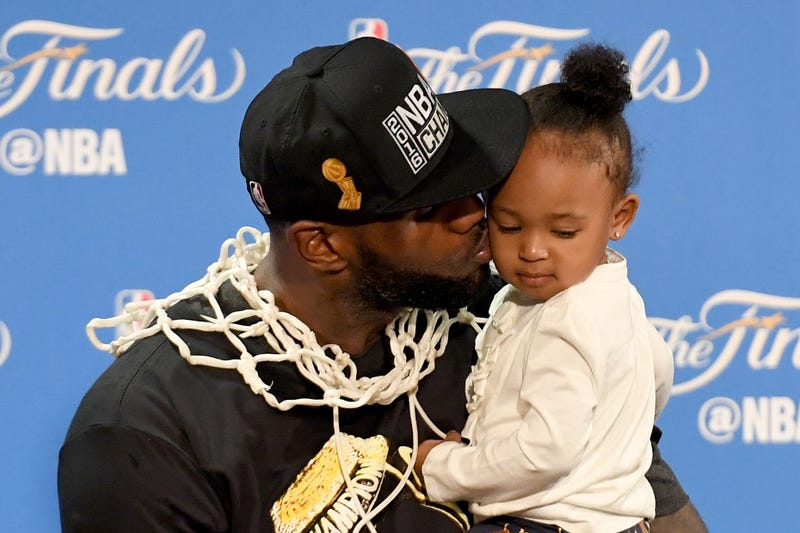 LeBron James of the Cleveland Cavaliers kisses his daughter Zhuri during a press conference following the Cavs' defeat of the Golden State Warriors 93-89 in Game 7 to win the 2016 NBA Finals June 19, 2016, in Oakland, Calif. Thearon W. Henderson/Getty Images