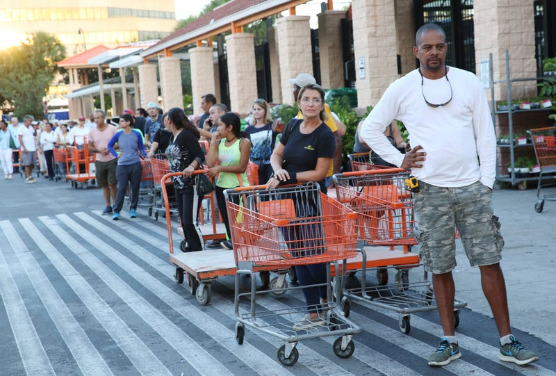 Eduardo Soriano of Miami, in front, started waiting in this line at dawn to purchase plywood sheets at a Home Depot store in North Miami, Fla., on Sept. 6, 2017.  (Marta Lavandier/AP Images)