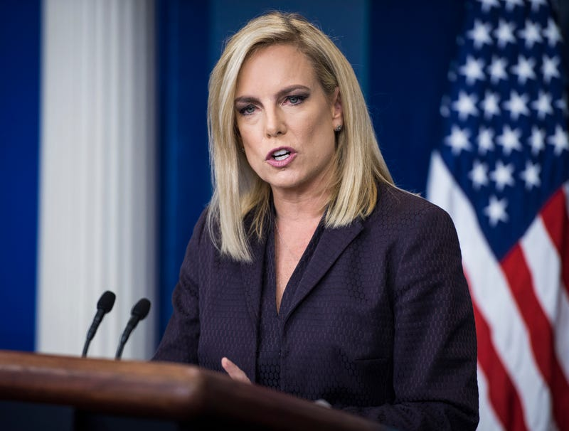 Illustration for article titled Kirstjen Nielsen Urges Migrant Parents Leave The Weak Ones Behind
