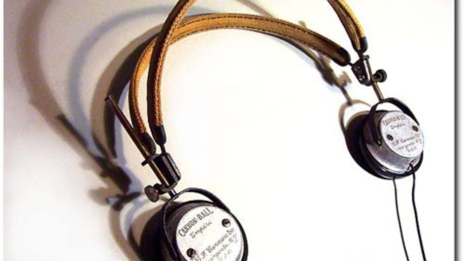ear buds logetaris - Steampunk Artist Mods Vintage Headphones into Gadget-Compatible Cans