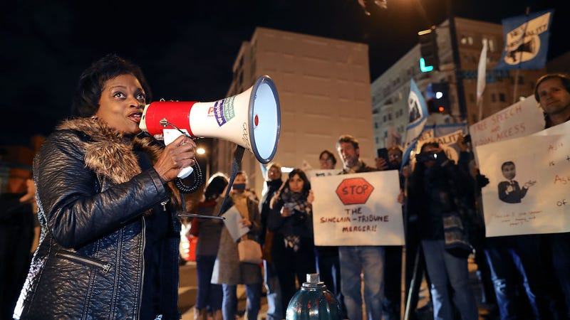 FCC Commissioner Mignon Clyburn uses a megaphone to address about 60 demonstrators gather outside of the 31st Annual Chairman's Dinner to show their support for net neutrality on December 7, 2017 in Washington, DC (Photo: Getty)