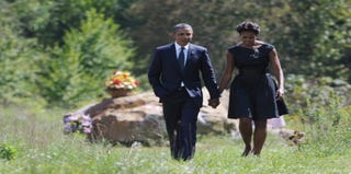 President and Mrs. Obama remember 9/11 victims. (Getty)