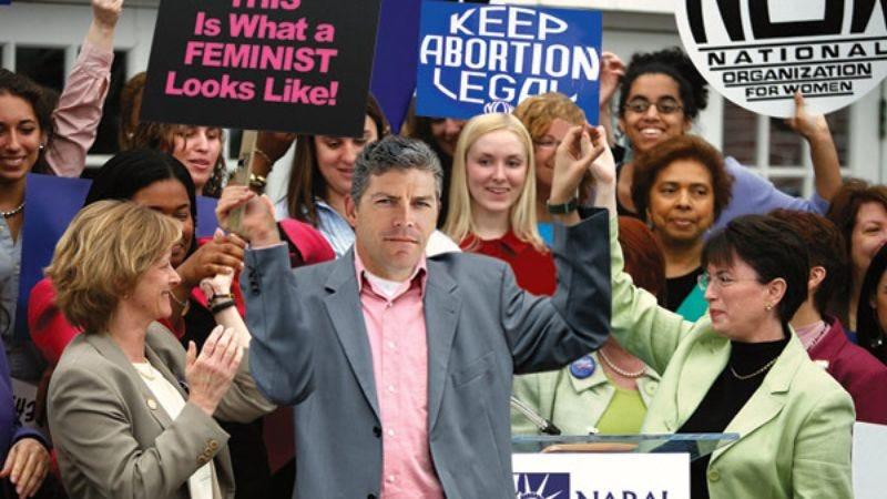 "Head feminist ""Buck"" McGowan leads a march on Washington for women's rights."