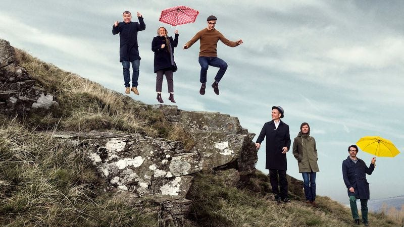 Murdoch, in the hat, with the rest of Belle And Sebastian