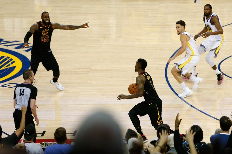 J.R. Smith, No. 5 of the Cleveland Cavaliers, dribbles in the closing seconds of regulation as LeBron James, No. 23, attempts to direct the offense against the Golden State Warriors in Game 1 of the 2018 NBA Finals at Oracle Arena on May 31, 2018, in Oakland, Calif.