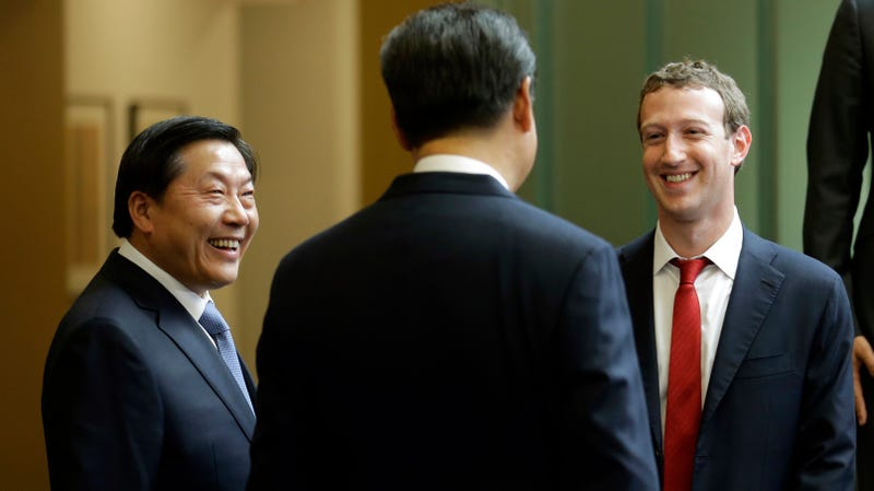 Lu Wei, left, seen with Chinese President Xi Jinping (center) and Facebook CEO Mark Zuckerberg (right) in 2015.