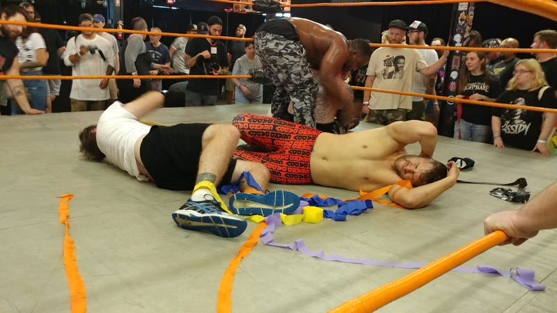 A.J. Gray tends to Kerry Awful as Dylan Hales and Nick Iggy recover from their beating at the hands of Curt Stallion, O'Shay Edwards, and Brett Ison.